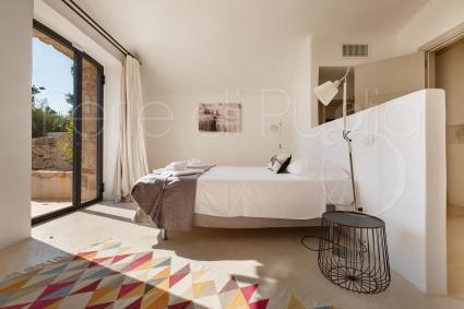 The master bedroom has a king-size bed, a bathtub and an en suite bathroom