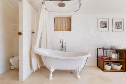 A unique bathtub, directly in the room
