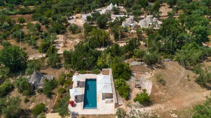 The luxury villa with swimming pool immersed in the Valle d`Itria, taking with a drone view
