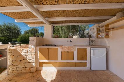 There is a very comfortable outdoor kitchen for preparing meals outdoors and enjoying nature