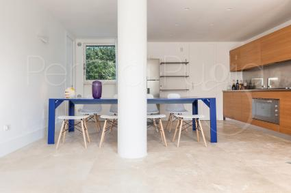 kitchen on the ground floor and table for ten people