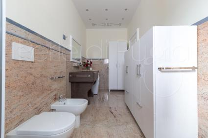 There are several bathrooms in the service of luxury villa for rent
