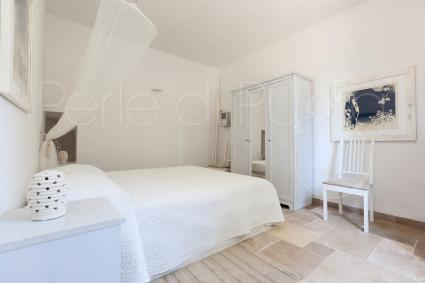 The second bedroom has a French bed, suitable for one or two people