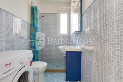 Bathroom with washing machine on the ground floor