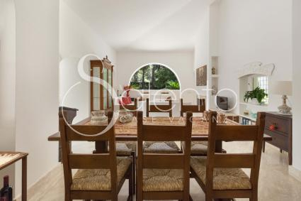 The bright dining area is adjacent to the living room