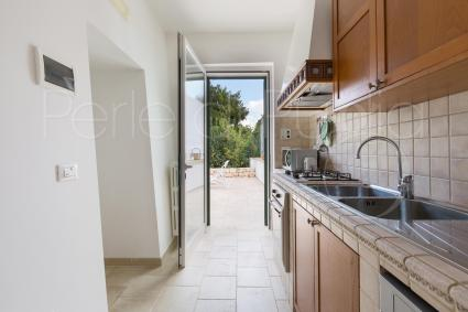 The kitchen has access to the garden and the verandah