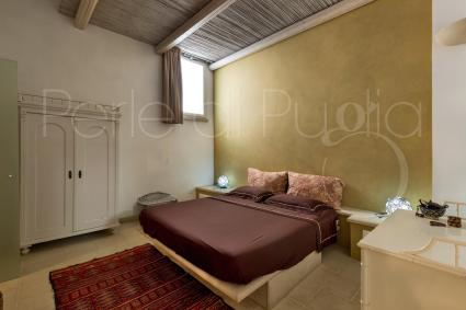 The first double bedroom is offered in warm colors, makes you think  of the desert
