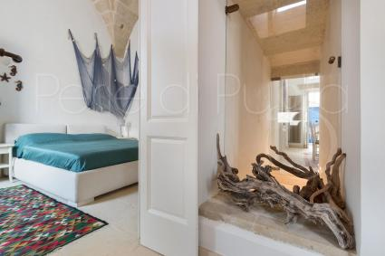 The second bedroom is in Mediterranean marine style, in white and blue colors