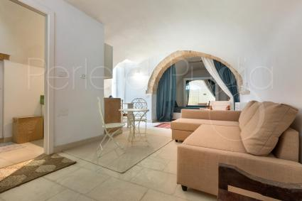 The two-room apartment also has a living area with a comfortable sofa