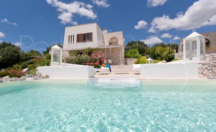 the view of the villa from the pool